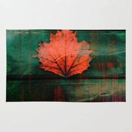 Rusty red dried fall leaf on wooden hunter green beams Rug