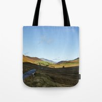 cassia beck Tote Bags featuring Views from Keskadale and Keskdale Beck back down the Pass. Lake District, UK. by liamgrantfoto