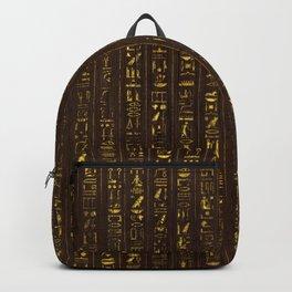 Golden Egyptian  hieroglyphics on wood Backpack