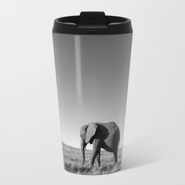 Lone female elephant walking along African savanna Travel Mug