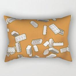 Falling Objects: Little Bricks on Orange Rectangular Pillow