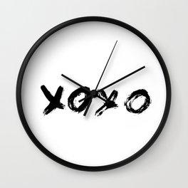 XOXO hand written phrase. Hugs and kisses. Grunge brush lettering. Wall Clock