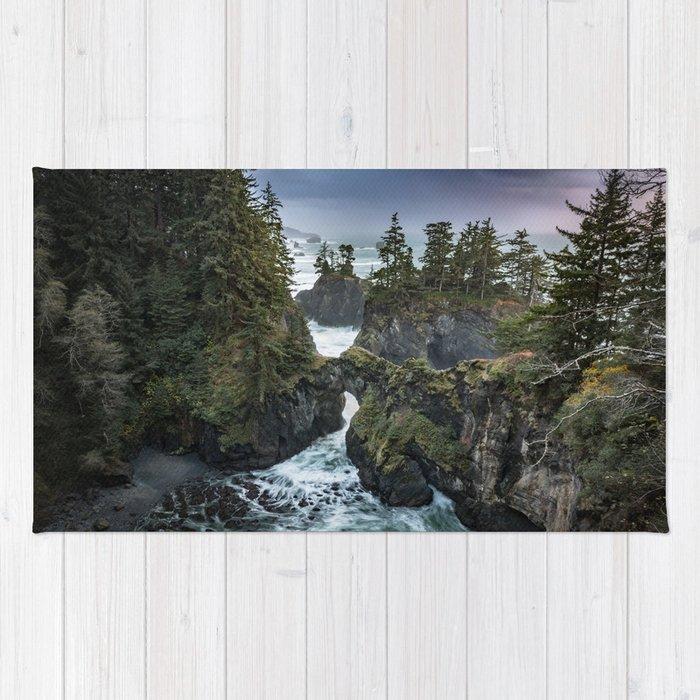 Oregon's Natural Bridges at sunset Rug