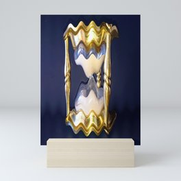 Abstract sands of time in a warped classic shaped brass hourglass Mini Art Print