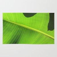 banana leaf Area & Throw Rugs featuring Banana Leaf, Dark Shadows by Glenn Designs