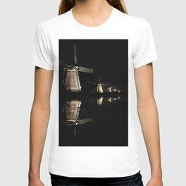 Floating illuminated windmills in the night T-shirt