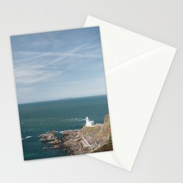 Lighthouse at Hartland Quay with Lundy Island beyond. Devon, UK. Stationery Cards