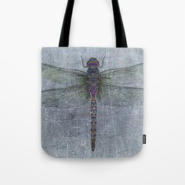 Dragonfly on blue stone and metal background Tote Bag