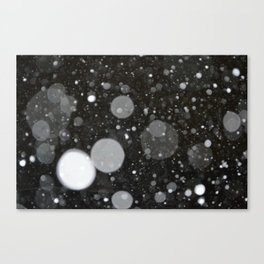 Light in the Dark-Photo of light colored circles on a dark surface Canvas Print