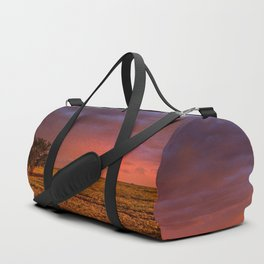 Fire Within - Red Sky and Rainbow Over Lone Tree on Great Plains Duffle Bag
