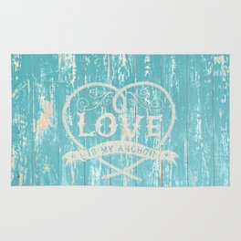 Maritime Design - Love is my anchor on teal grunge wood background Rug