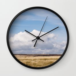 Blue sky and white clouds above sunlit moorland. Derbyshire, UK. Wall Clock