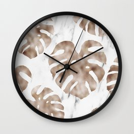 Rose gold monstera on white marble Wall Clock