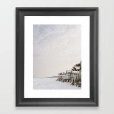 Beach huts and snow covered beach. Wells-next-the-sea. Framed Art Print
