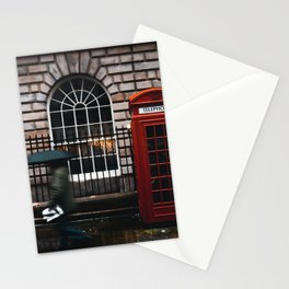 TIME LAPSE PHOTOGRAPHY OF WOMAN WALKING ON STREET WHILE HOLDING UMBRELLA NEAR LONDON TELEPHONE BOOTH BESIDE WALL Stationery Cards
