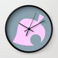animal crossing Wall Clocks featuring Animal Crossing Winter Leaf by Rebekhaart