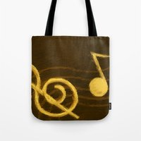 music notes Tote Bags featuring Golden Umber Music Notes by Tina A Stoffel Arts