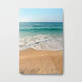 Sandy beach at noon with blue water and clear sky Metal Print