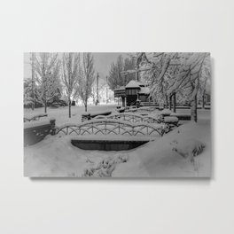 Snowy night in a little town. Metal Print