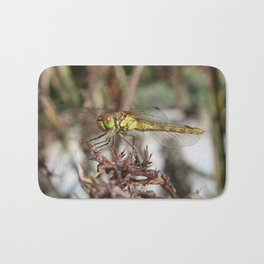 Brown Dragonfly On Husks With Garden Background Bath Mat