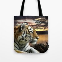 novelty Tote Bags featuring Sunset Tiger by Moody Muse