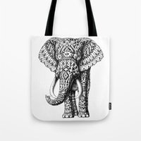 ornate elephant Tote Bags featuring Navajo Elephant by BIOWORKZ