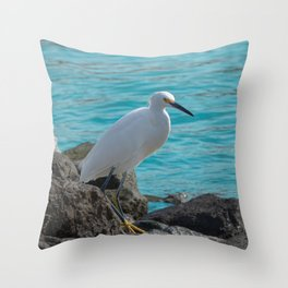 Snowy Egret on Jagged Rocks by Ocean Throw Pillow