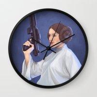 leia Wall Clocks featuring Leia by Sara Meseguer