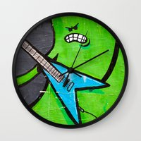 heavy metal Wall Clocks featuring Heavy Metal by Chantal Seigneurgens