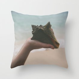 Hand Holding Conch Shell by Ocean Throw Pillow