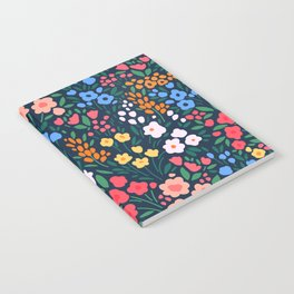 Vintage floral background. Flowers pattern with small colorful flowers on a dark blue background.  Notebook