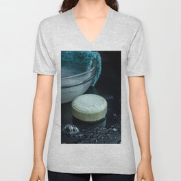 Wet french soap bar with bubbles on wet dark background Unisex V-Neck