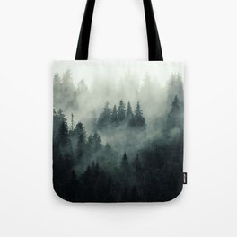 Green misty mountain pine forest in cloudy and rainy - vintage style photo Tote Bag