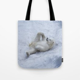 Portrait of polar bear cub practicing yoga on the snow. Tote Bag