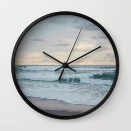 Soft turquoise waves wash up on a paradise beach in Costa Rica at a candyfloss pink sunset Wall Clock