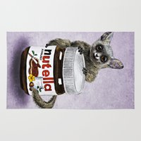 nutella Area & Throw Rugs featuring Sweet aim // galago and nutella by Anna Shell