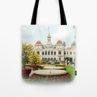 vietnam Tote Bags featuring saigon-vietnam by nguyenkhacthanh