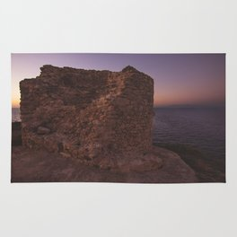 old defense tower at sunset Rug