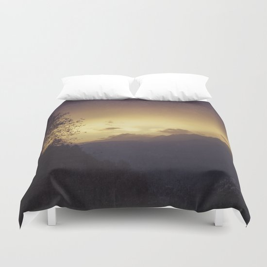 Chasing the night away Duvet Cover
