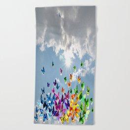 Butterflies in blue sky Beach Towel