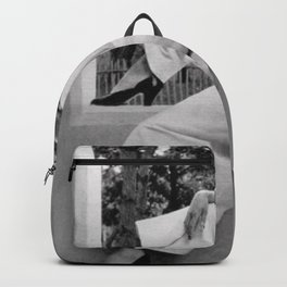 Roaring Twenties Jazz Age Flapper relaxing in high fashion black and white photograph Backpack