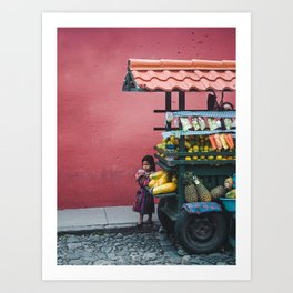 Young Guatemalan girl in traditional Mayan dress watches the street from behind a fruit stall cart Art Print