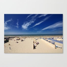 On the beach, blue sky Canvas Print