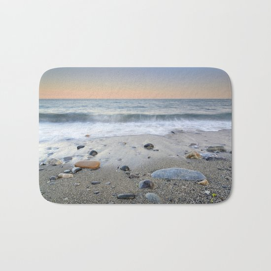 """Mediterranean waves at sunset"". Pink sunset Bath Mat"