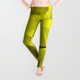 Repetitive overlapping sheets of yellow paper triangles. Leggings