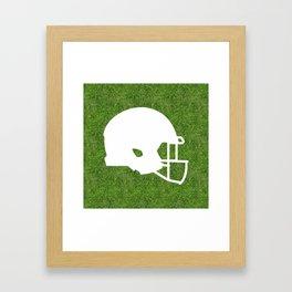 american football helmet symbol on the grass Framed Art Print