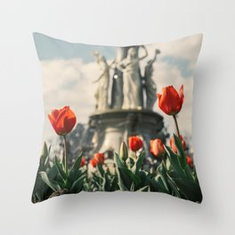 Tulips in front of a fountain. Throw Pillow