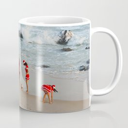 Christmas background. Happy girls in Santa Clause suit having fun on the beach. Coffee Mug