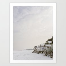 Beach huts and snow covered beach. Wells-next-the-sea. Art Print