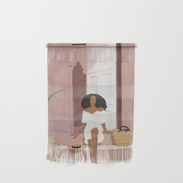 Woman sitting on the porch Wall Hanging